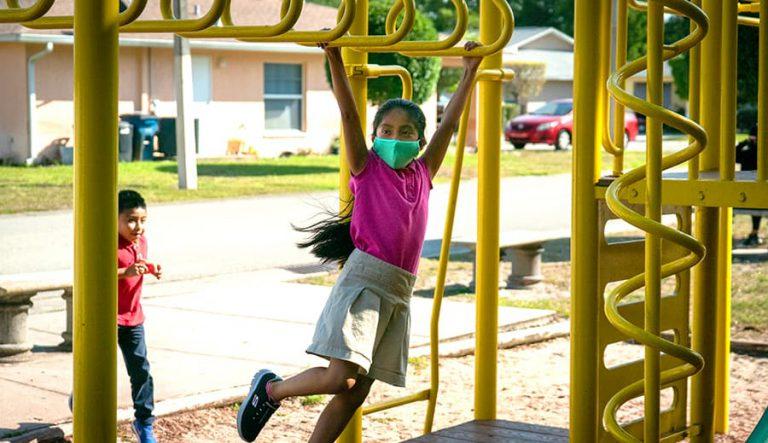 Girl playing on monkey bars