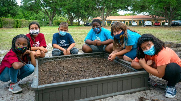 Kids Gathered Around Mulch Pit