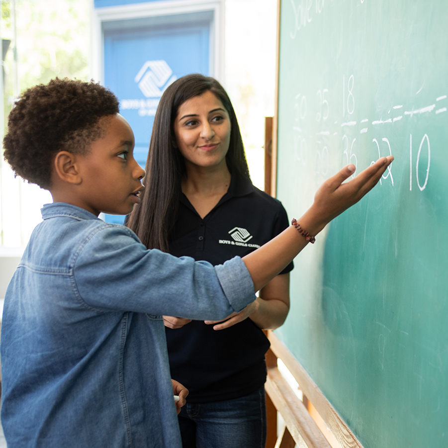 Student working with mentor at Chalkboard