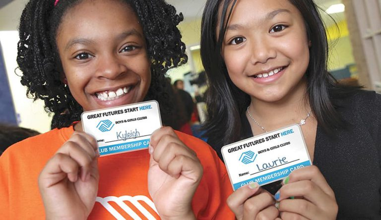 Two girls with membership cards